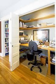 cole street elegant home office photo in san francisco with gray walls medium tone hardwood floors beautiful office desks san