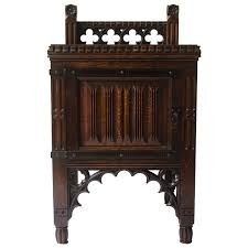 bruce talbert gothic revival oak night table with carved linen fold carvings for