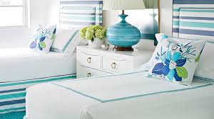 blue and white furniture. Twin Beds Decked Out In Turquoise And Nearly Indigo Blue Pop Against Crisp White Walls Furniture