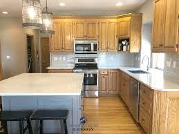 Golden Oak Kitchen Cabinets With White Quartz Countertop Subway