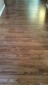 refinished hardwoods in coffee ebony light sanding to get a light look instead of