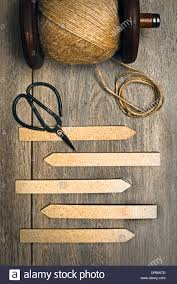 garden herb labels with string and scissors