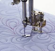 Sewing Machine With Quilting Foot