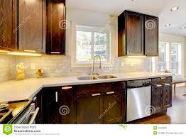 Dark Brown Cabinets Kitchen Kitchen Room Dark Brown Cabinets And White Appliances Stock