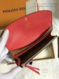 louis vuitton emilie wallet. it come with serial numbers, louis vuitton authenticity card, dust bag and care booklet. emilie wallet