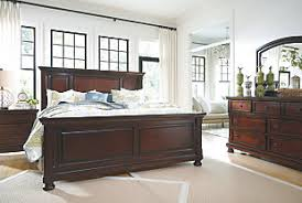 ashley furniture bedroom suites. angled view of porter traditional dark wood bedroom set ashley furniture suites l