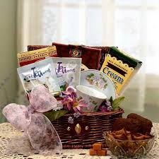 tea gift basket teacup and saucer ortment of teas chocolate scones mix preserves cookies