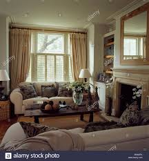 Townhouse Living Room Cream Sofas In Townhouse Living Room With Cream Curtains And Stock