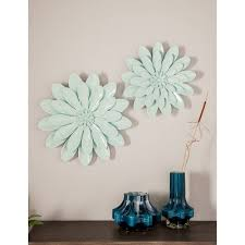 This sculptural set of three ceramic flowers is hand crafted of terra cotta and finished in a fresh white glaze to bring out each bloom's natural details. Ceramic Flower Wall Decor Target