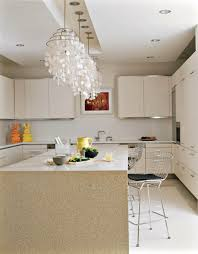 luxury crystal pendant lights over brown granite kitchen island paired with stainless steel chairs