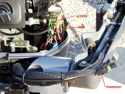 upgrade your outboard motor to charge your battery the tingy sailor front of motor showing wiring connections and male connector