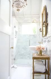 french bathroom with paris flea market chandelier