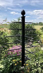 unusual metal garden obelisk adorned