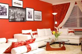 ... Small living room with red walls and Noguchi table [By: Marie Burgos  Design]