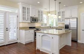 engineered oak hardwood flooring in white traditional kitchen with yellow granite counter