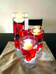 oversized wine glass centerpiece candle and cranberries floating on water in a wine glass centerpiece ideas