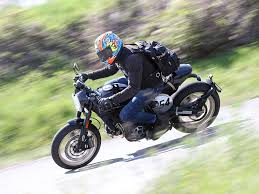 video why the ducati scrambler caf racer s beauty is more than