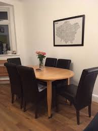 for john lewis extending dining table and six leather dining chairs
