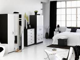 white room with black furniture. Black Furniture Room Ideas. Bedroom Ideas White Stripes Bed Cover Modern Style Wardrobe With .