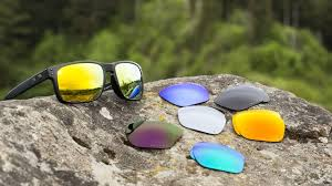 sunglasses and replacement lenses on a rock