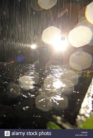 Looking For The Light Through The Pouring Rain In The Pouring Rain A Car Drives Through A District That