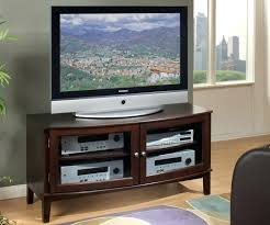 tv stands 70 inch wooden curved media console with glass door and flat placed on wooden