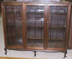 small glass door bookcase luxury petite walnut antique triple door bookcase inside antique bookcase image