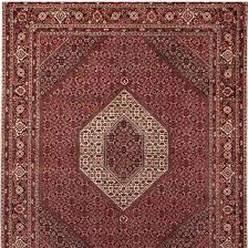 the most densely knotted of all persian carpets renowned for its significant colours of pale blue and pale purple with wool coming from mountain sheep