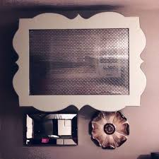 What a cute way of covering up window unit. She is so crafty! Love this!