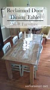 a fun way to use vine finds an antique door repurposed into a gorgeous dining