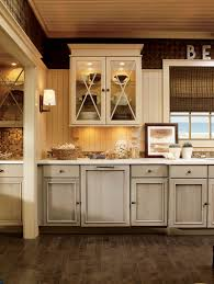 upper cabinet lighting. The Kitchen Is Fitted With KraftMaid Maple Cabinets In Two Sea- And Sand-inspired Colors. Upper Feature Antiquity Glass Doors Cabinet Lighting I