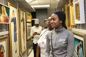 career exploration at coca cola a photo essay   cehd early college students look at framed coca cola artwork
