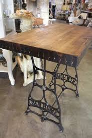 re purposed antique black iron pedestal sewing machine with handsome butcher block demi size work table