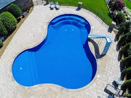 custom lagoon inground pool with built in bench step