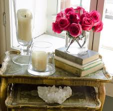 candles flowers books and interior decorating