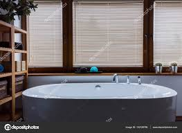bathroom in a day. Relaxing Bathroom Shaded From The Worries Of Day \u2014 Stock Photo. Elegant Oval Bathtub In A S