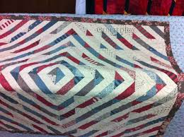 Peggy's Merry Go Round Quilt - & Don't you love scrappy quilts? Adamdwight.com
