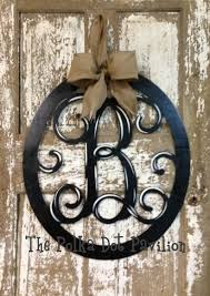 front door monogramOval Initial monogram wreath Would be perfect since we have