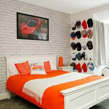 White teenage boy's bedroom with cap wall display, formula 1 poster and  white exposed brick