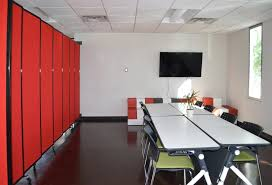 office wall divider. A Wall Mounted Room Divider Breaks Up This Co-working Space When Needed For Meetings Office