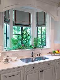 Beautiful Roman Shades enhance this Kitchen's bay window