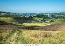 Hilly landscape above the town of Glossop in North Derbyshire, England. A  sunny summer