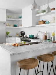 Small Kitchen Apartment Therapy Kitchen Galley Kitchen Layout In White With Crown Molding Via