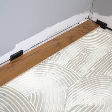 glue down can be another optional installation method for installing tongue and groove engineered wood flooring
