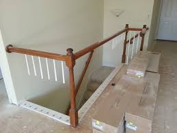removed wooden spindles replaced with iron iron spindles are stock items at when replacing the flooring we removed the base board that held the