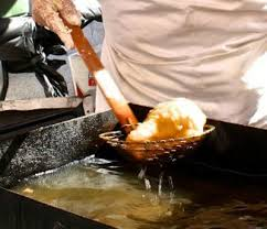 removing indian fry bread from fryer