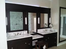 three section wall mirror with black wooden frame added fluorescence wall lights above bathroom vanity with black and white bathroom furniture