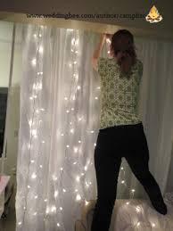 lighting curtains. woman pinning lights to curtain lighting curtains