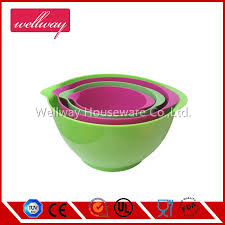 red and green large mixing bowl with handle