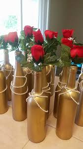 great gatsby themed 50th birthday centerpieces gold with pearls and red roses